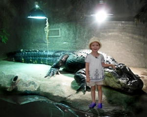my little girl and a croc